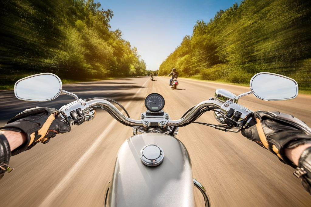 Point of View of Motorcycle Biker on road trip